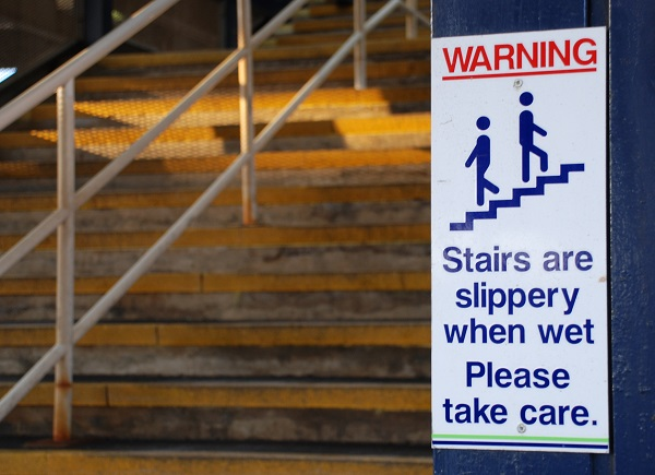 Sign: Stairs are slippery when wet. take Care
