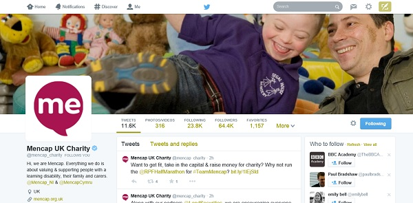 Mencap: strong image of boy and man smiling