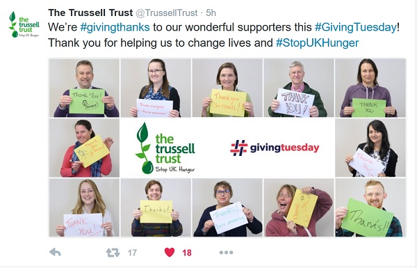 Trussell Trust's staff hold up thank you signs