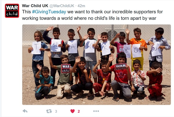 Children hold up letters spelling out 'Thank You'