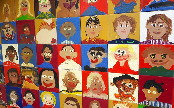 colourful children's drawings of faces