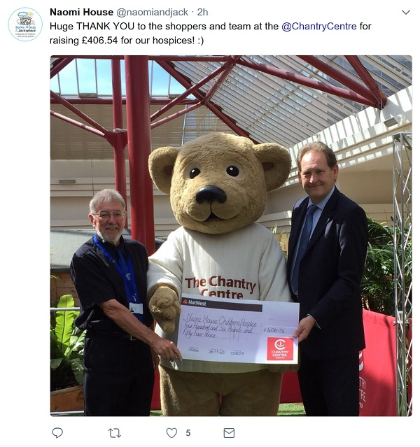 Cheque presentation with a giant teddy bear