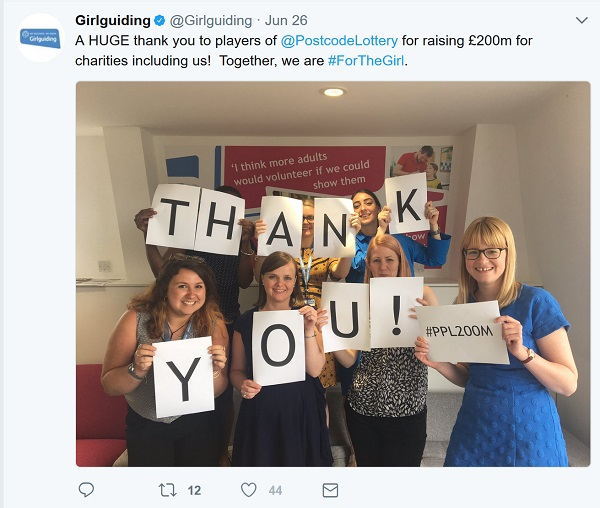 Thank you in big letters held up by the Girl Guiding team