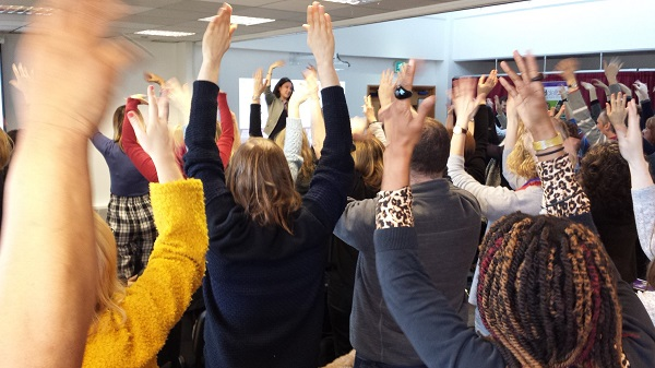warm-up exercise at SMEX18 - everyone with their arms in the air