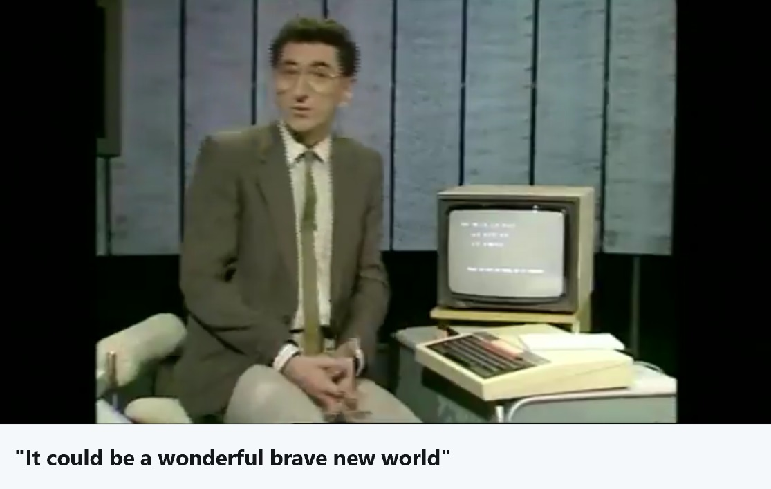 1970's BBC presenter next to a BBC micro computer.