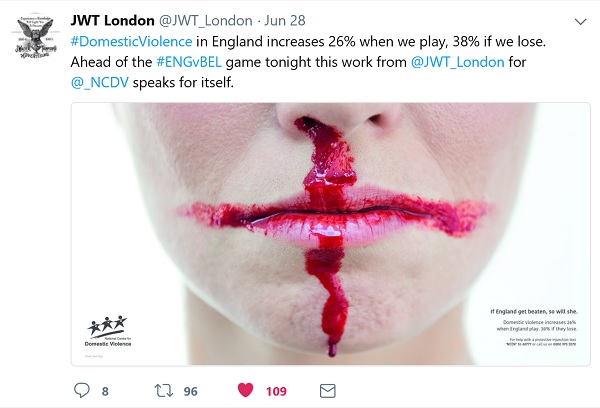Lower half of white woman's face. She has blood dripping from her nose and wiped across her mouth. Looks like the England flag.