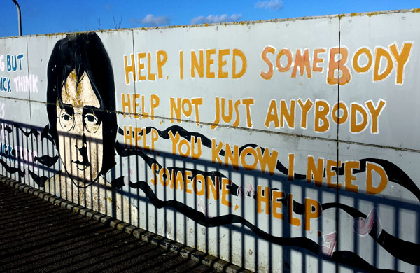 photo of street art - john lennon's face next to the words Help, I need somebody, help, not just anybody
