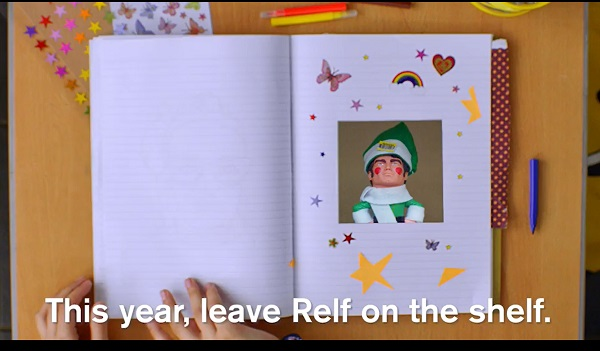 Action Man style elf - text says 'This year, leave Relf on the shelf'