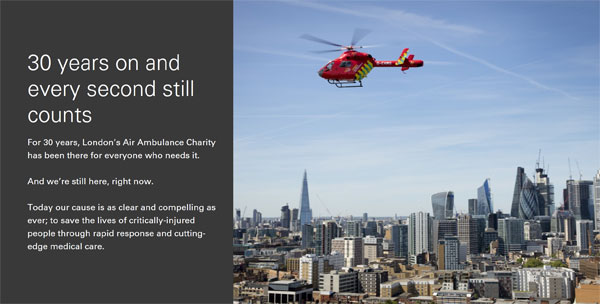 screenshot from LAA website. Red helicopter against blue sky over London.