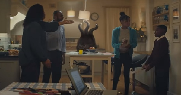 Family have an argument in their kitchen. Monster with tentacles sits on the table. Still from campaign video.