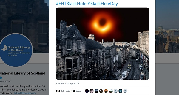 screenshot of National Library of Scotland's tweet showing the black hole over the Edinburgh skyline