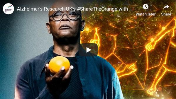 screenshot of Samuel L Jackson's ARUK film. He holds an orange.