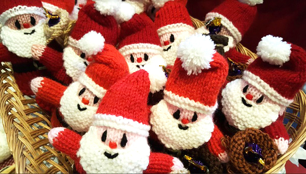 knitted santas in a box. smiling!