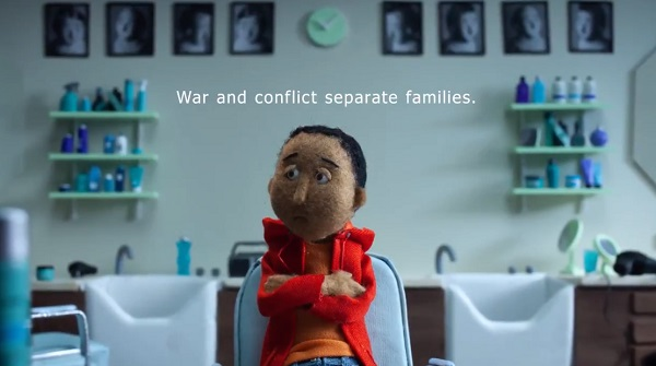 Animation by British Red Cross. Shows a young boy looking sad. Text above his head says 'War and conflict separate families'